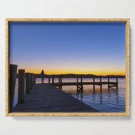 Silhouette of a woman on a pier at sunet Serving Tray