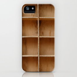 Empty wooden cabinet with cells iPhone Case