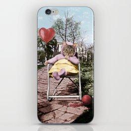 A pretty, little kitty with a heart-shaped balloon iPhone Skin