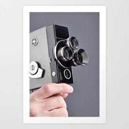 Retro hobbies movie camera in hands Art Print