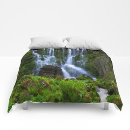 Waterfall in the mountain park Comforters