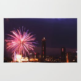Firework in storm clouds Rug