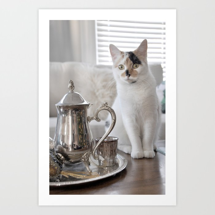 Kitten at a tea party Art Print