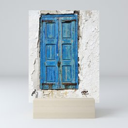 Blue Shuttered Window in Mykonos island in Greece Mini Art Print