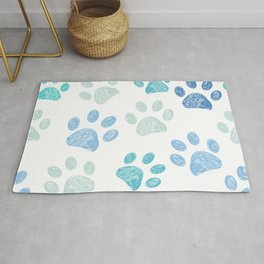 Blue colored paw print background Rug