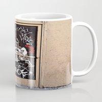 grafitti Mugs featuring Grafitti Door - Creep by Barbara Gordon Photography