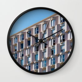 LOW ANGLE PHOTO OF GRAY CONCRETE BUILDING Wall Clock