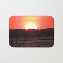 Sunset over water Bath Mat