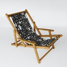 Curiosities: Bone Black Sling Chair