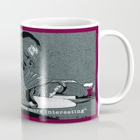 hemingway Mugs featuring Ernest Hemingway Drink Quote by Rising Trout Design
