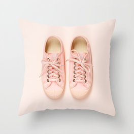 Pink canvas sneakers on pink background, close up Throw Pillow