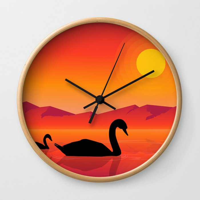 Silhouettes of Swans at Sunset Wall Clock