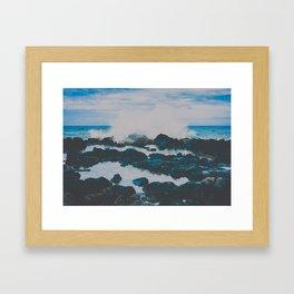 blue wave crashing on black rocks with tide pools Framed Art Print