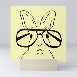 Easter Bunny With Glasses On Yellow Background Mini Art Print