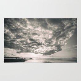 Dark clouds in sunset Rug