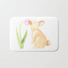 Bunny smelling a Tulip Bath Mat