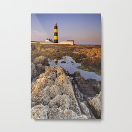 Lighthouse in Northern Ireland at sunset Metal Print
