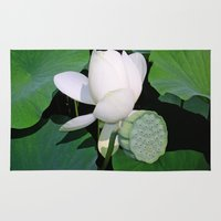 lotus flower Area & Throw Rugs featuring Lotus. by Assiyam