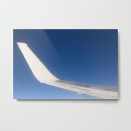 Airplane Wingtip on a blue sky Metal Print