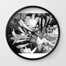 Black & White photo of the flowers outfront Wall Clock