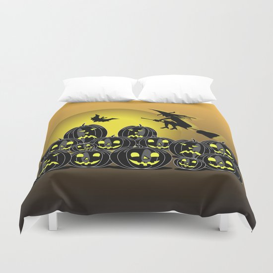 Pumpkins and witch in front of a full moon Duvet Cover