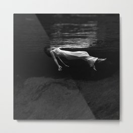 Underwater view of a woman floating in water Metal Print