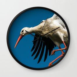 white stork landing on nest Wall Clock