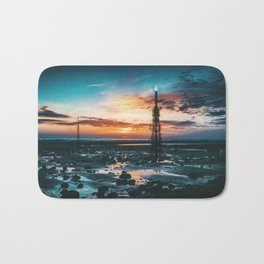 Beacons: Towers crowned by Flames on a Sunrise Beach Bath Mat