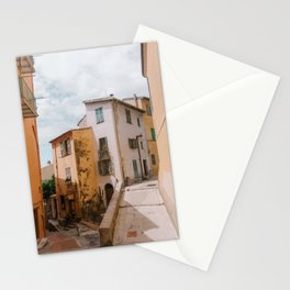 Alley corner full of orange and yellow houses in Menton, part of the French Riviera (France, South Europe) | Colorful travel photography art Stationery Cards
