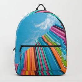 Colorful Rainbow Pipes Against Blue Sky Backpack