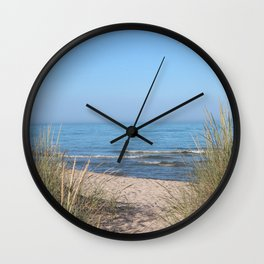 Relaxing at the beach Wall Clock