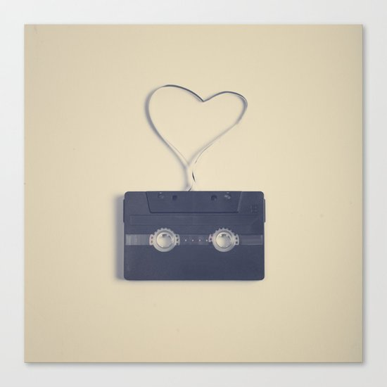 Retro black music cassette and heart shaped tape on beige background Canvas Print