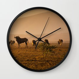 Herd of Wildebeest grazing in South Africa Wall Clock