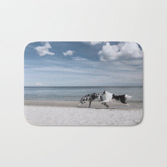 Running dogs at the beach Bath Mat