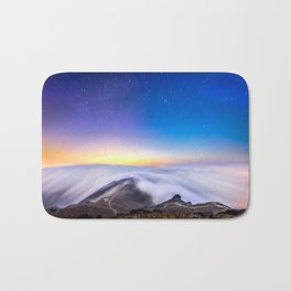 sea of clouds under starry night sky Bath Mat