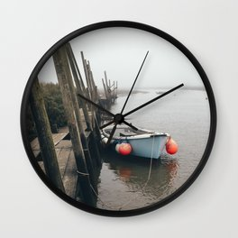 Boats moored at Blakeney in fog. Norfolk, UK. Wall Clock