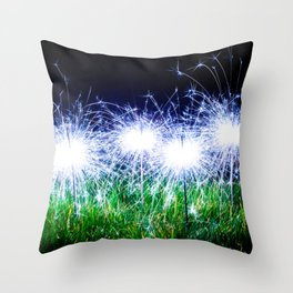 Blue sparklers in the grass Throw Pillow