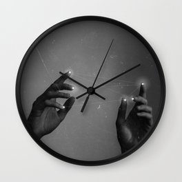 to catch a star on your fingertips Wall Clock