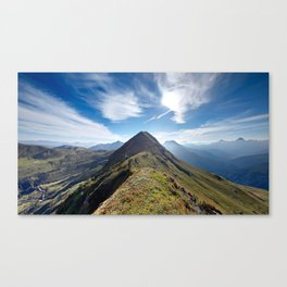 Mountain top with cloudy sky Canvas Print