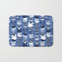 Swedish folk cats I // Indigo blue background Bath Mat