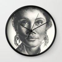gemma Wall Clocks featuring Gemma  by Lucy Schmidt Art