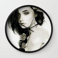 katniss Wall Clocks featuring Katniss by Isaiah K. Stephens