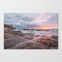 Rocky beach at sunset Canvas Print