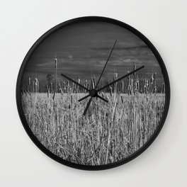 Cattails and reeds in the marsh Wall Clock