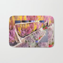 shelves with blooming heather Bath Mat