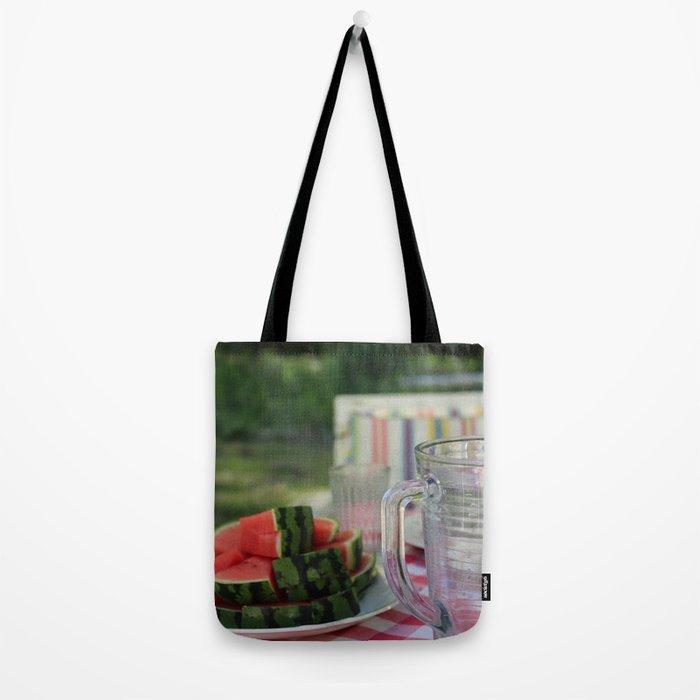 Watermelon and water carafe on garden table Tote Bag