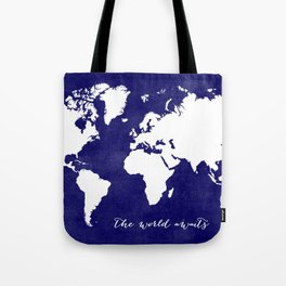 The world awaits in navy blue Tote Bag