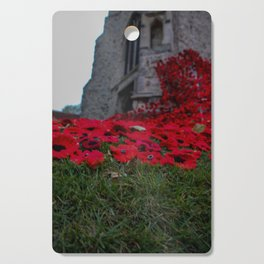 poppies up the church Cutting Board
