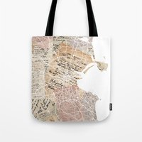 dublin Tote Bags featuring Dublin map by Mapsland