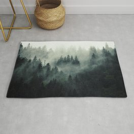 Green misty mountain pine forest in cloudy and rainy - vintage style photo Rug